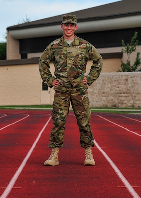Senior Airman Nathaniel Kjos, a geospatial intelligence analyst with the 11th Special Operations Intelligence Squadron, poses for a photo at Hurlburt Field, Fla., Aug. 19, 2016. Kjos is one of the four Airmen representing Hurlburt Field as part of the Air Force Special Operations Command's 10-man marathon team that is scheduled to participate in the Air Force Marathon.