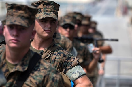 WHITE BEACH, Okinawa, Japan, (Aug. 20, 2016) – Marines with the 31st Marine Expeditionary Unit wait on the gangplank before boarding the USS Bonhomme Richard at White Beach, Okinawa, Japan, Aug. 20, 2016. The 31st MEU is embarked aboard the ships of the Bonhomme Richard Amphibious Ready Group during a regularly scheduled patrol of the Pacific region.