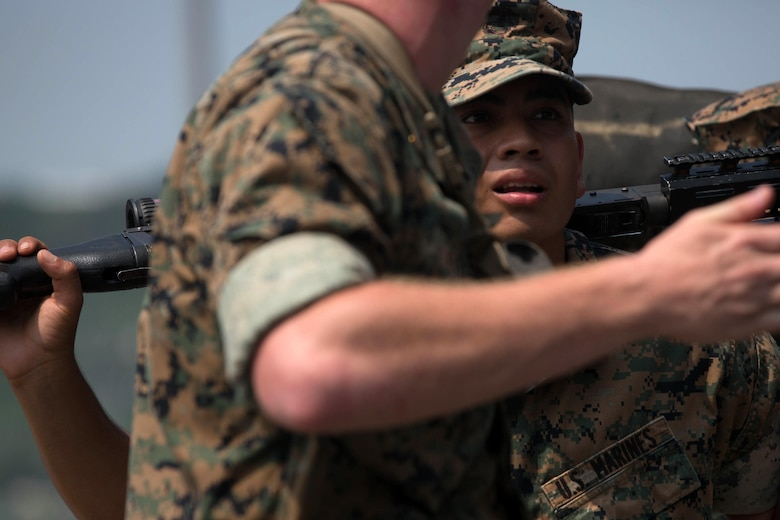 WHITE BEACH, Okinawa, Japan, (Aug. 20, 2016) – A Marine with the 31st Marine Expeditionary Unit waits on the gangplank before boarding the USS Bonhomme Richard (LHD-6) at White Beach, Okinawa, Japan, Aug. 20, 2016. The 31st MEU is embarked aboard the ships of the Bonhomme Richard Amphibious Ready Group during a regularly scheduled patrol of the Pacific region.