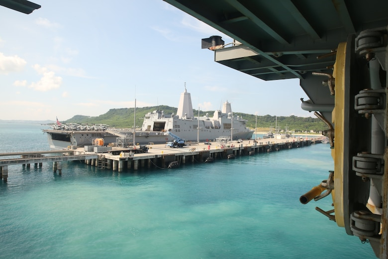 WHITE BEACH, OKINAWA, Japan – The USS Green Bay, as seen from the lower decks of the USS Bonhomme Richard Aug. 21, 2016.  Marines and Sailors of the 31st Marine Expeditionary Unit have embarked onto the USS Bonhomme Richard Amphibious Ready Group, beginning their annual fall patrol from White Beach, Okinawa, Japan. This regularly-scheduled patrol of the Pacific region is designed to enhance interoperability between the U.S. partner nations. (U.S. Marine Corps photo by Lance Cpl. David A. Diggs/Released)