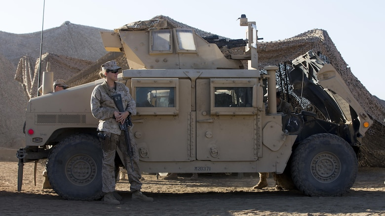 U.S. Marine Cpl. Victoria Demoss, Company A, Law Enforcement Battalion, I Marine Expeditionary Force Headquarters Group, stands in front of a Humvee as she waits to conduct training during I MEF Large Scale Exercise 2016 at Marine Corps Air Station Miramar, Calif., Aug. 17, 2016. LSE-16 is designed to enhance the command and control and interoperability between I MEF Command Element staff and its higher, adjacent and subordinate command headquarters. The exercise includes cyber and electronic warfare, information support operations, and simulated and live-fire events.