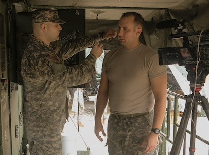 FORT HOOD, Texas – Spc. Logan Rath, an Army Reserve public affairs broadcaster, prepares to interview Spc. Jarod Neven on Aug. 16, 2016, about the laundry advance system used for operations by the 340th Quartermaster Company. (U.S. Army Reserve photo by Sgt. Michael Adetula/Released)