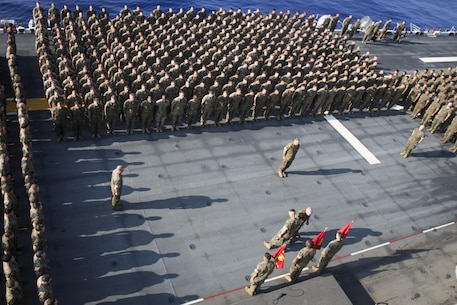 U.S. Marine Corps Col. Tye R. Wallace addresses the Marines and Sailors assigned to the 31st Marine Expeditionary Unit for the first time since setting sail on the USS Bonhomme Richard, at sea, in Japan on Aug. 22, 2016. The 31st MEU is currently underway and on patrol around the Asia-Pacific region. The 31st MEU is the Marine Corps' only continuously forward-deployed Marine Air-Ground Task Force, and combines air-ground-logistics into a single team capable of addressing a wide variety of military operations in the Asia-Pacific region – from force projection and maritime security to humanitarian assistance and disaster relief in cooperation with host countries and partner militaries.(U.S. Marine Corps photo by Lance Cpl. Jay Parks, 31st Marine Expeditionary Unit/ Released)