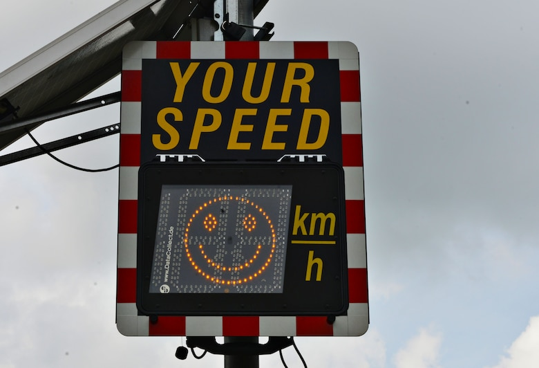 A speed limit sign displays a happy face when motorists adhere to the speed limit at Ramstein Air Base, Germany. The 86th Airlift Wing Safety office advises motorists to exercise caution in school zones to avoid potential mishaps. (U.S. Air Force photo Airman 1st Class Joshua Magbanua)