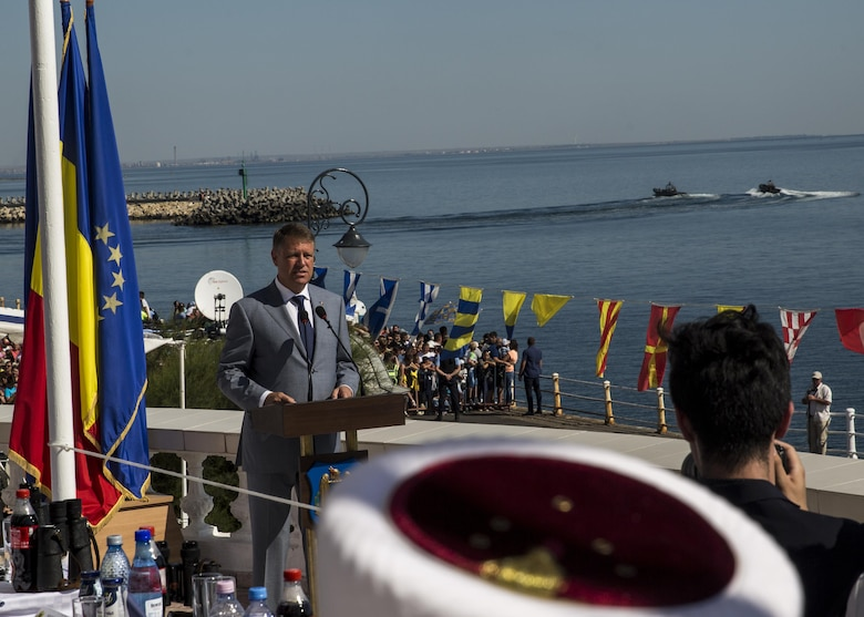 Klaus Iohannia, president of Romania, welcomes guests and U.S. Sailors and Marines supporting the Black Sea Rotational Force 16.2 to the 114th annual Navy Day celebration at the Port of Constanţa, Romania, Aug. 15, 2016. The day payed tribute to the prestigious history of the Romanian navy and highlighted the military's movement toward new developments and modernizations. Black Sea Rotational Force is an annual multilateral security cooperation activity between the U.S. Marine Corps and partner nations in the Black Sea, Balkan and Caucasus regions designed to enhance participants' collective professional military capacity, promote regional stability and build enduring relationships with partner nations. (U.S. Marine Corps photo by Sgt. Michelle Reif)