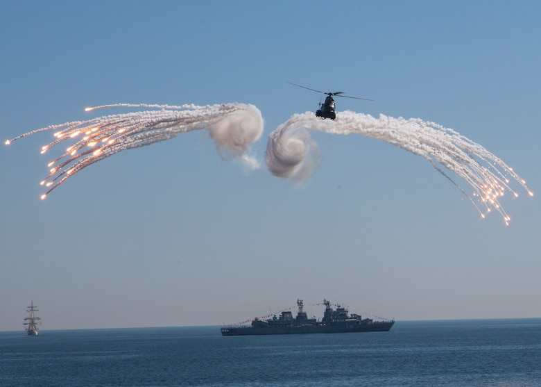 The Romanian navy demonstrates its power during the 114th annual Navy Day celebration at the Port of Constanţa, Romania, Aug. 15, 2016. U.S. Sailors and Marines supporting the Black Sea Rotational Force 16.2 helped pay tribute to the prestigious history of the Romanian navy and highlighted the military's movement toward new developments and modernizations. Black Sea Rotational Force is an annual multilateral security cooperation activity between the U.S. Marine Corps and partner nations in the Black Sea, Balkan and Caucasus regions designed to enhance participants' collective professional military capacity, promote regional stability and build enduring relationships with partner nations. (U.S. Marine Corps photo by Sgt. Michelle Reif)