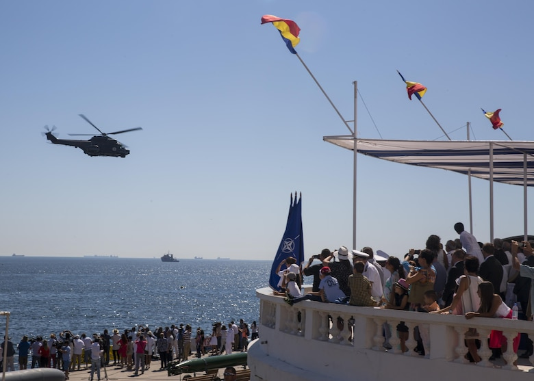 A Romanian helicopter delights a crowd of spectators during the 114th annual Navy Day celebration at the Port of Constanţa, Romania, Aug. 15, 2016. U.S. Sailors and Marines supporting the Black Sea Rotational Force 16.2 helped pay tribute to the prestigious history of the Romanian navy and highlighted the military's movement toward new developments and modernizations. Black Sea Rotational Force is an annual multilateral security cooperation activity between the U.S. Marine Corps and partner nations in the Black Sea, Balkan and Caucasus regions designed to enhance participants' collective professional military capacity, promote regional stability and build enduring relationships with partner nations. (U.S. Marine Corps photo by Sgt. Michelle Reif)