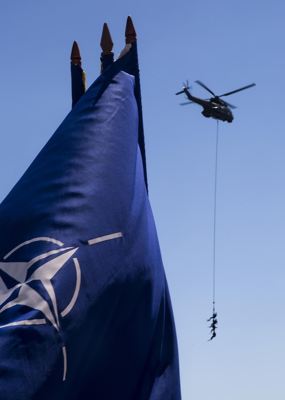 Three Romanian sailors hang suspended from a helicopter while a delighted crowd spectates during the 114th annual Navy Day celebration at the Port of Constanţa, Romania, Aug. 15, 2016. U.S. Sailors and Marines supporting the Black Sea Rotational Force 16.2 helped pay tribute to the prestigious history of the Romanian navy and highlighted the military's movement toward new developments and modernizations. Black Sea Rotational Force is an annual multilateral security cooperation activity between the U.S. Marine Corps and partner nations in the Black Sea, Balkan and Caucasus regions designed to enhance participants' collective professional military capacity, promote regional stability and build enduring relationships with partner nations. (U.S. Marine Corps photo by Sgt. Michelle Reif)