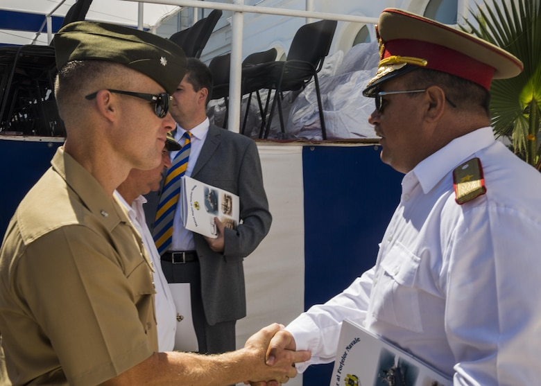 U.S. Marine Corps Lt. Col. Paul C. Teachey, the commanding officer of the Black Sea Rotational Force, shakes hands with Romanian Brigadier General Adrian Soci during the 114th annual Navy Day celebration at the Port of Constanţa, Romania, Aug. 15, 2016. Representatives from BSRF 16.2 attended the event as a sign of partnership before the first major exercise which will build security cooperation between nations in the Black Sea region. Black Sea Rotational Force is an annual multilateral security cooperation activity between the U.S. Marine Corps and partner nations in the Black Sea, Balkan and Caucasus regions designed to enhance participants' collective professional military capacity, promote regional stability and build enduring relationships with partner nations. (U.S. Marine Corps photo by Sgt. Michelle Reif)