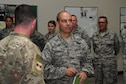 Lt. Gen. Jeffrey Harrigian, U.S. Air Forces Central Command commander, is briefed by Lt. Col. Corey Reed, 386th Expeditionary Operations Group deputy commander, Aug. 21, 2016, at an undisclosed location in Southwest Asia. Harrigian made his first visit to the base after taking command of AFCENT last month. (U.S. Air Force photo/Senior Airman Zachary Kee)