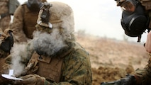 A Marine with Company C, 1st Battalion, 1st Marine Regiment, tests the air for safety after a gas attack August 18, 2016, at Bradshaw Field Training Area, Northern Territory, Australia. The range was the final training evolution of Exercise Koolendong 16, a trilateral exercise between the U.S. Marine Corps, Australian Defence Force and French Armed Forces New Caledonia. Marines held a defensive position while engaging targets and working through the CS gas, which simulated a chemical attack.