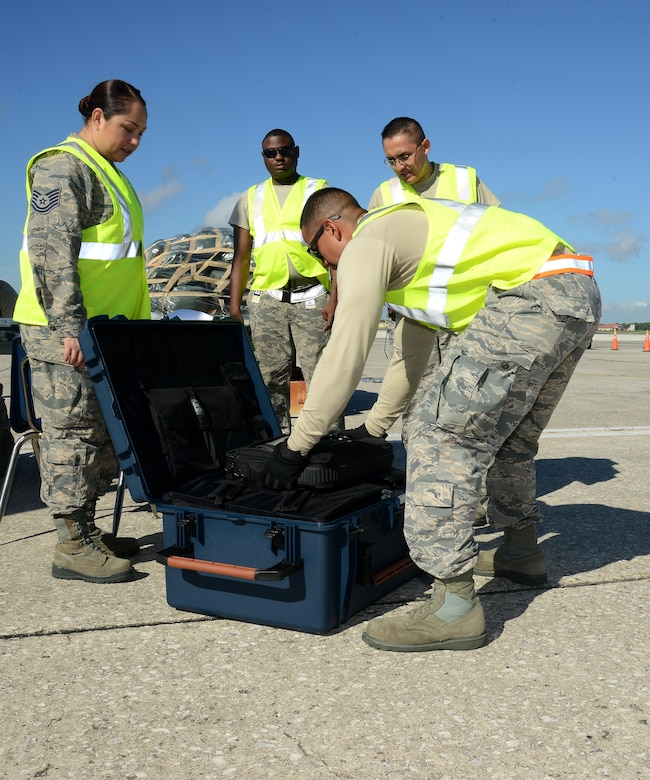 Staff Sgt. Allan Canizales, right, a mobility training instructor assigned to the 6th Logistics Readiness Squadron, inspects and processes cargo during a mobility exercise at MacDill Air Force Base, Fla., Aug. 16, 2016. Canizales checked that all equipment being processed matches the official records. (U.S. Air Force Photo by Airman 1st Class Rito Smith)