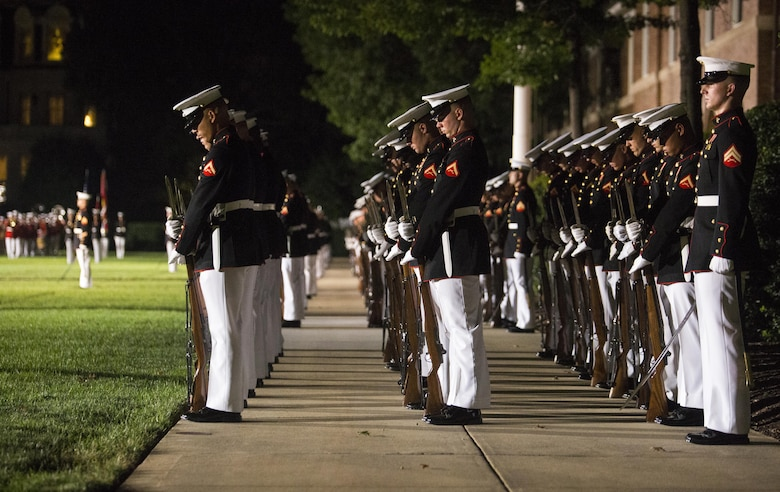 """Marines of Marine Barracks Washington, D.C., execute the command """"fix bayonets"""" during the Noncommissioned Officer's Parade at Marine Barracks, Washington, D.C., Aug. 19, 2016. The guest of honor for the parade was Adm. John M. Richardson, chief of Naval Operations and the hosting official was Gen. Robert B. Neller, commandant of the Marine Corps. (Official Marine Corps photo by Lance Cpl. Robert Knapp/Released)"""