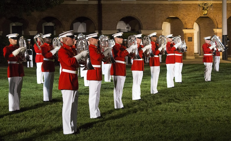 The United States Marine Drum & Bugle Corps perform during the Noncommissioned Officer's Parade at Marine Barracks Washington, D.C., Aug. 19, 2016. The guest of honor for the parade was Adm. John M. Richardson, chief of Naval Operations and the hosting official was Gen. Robert B. Neller, commandant of the Marine Corps. (Official Marine Corps photo by Lance Cpl. Robert Knapp/Released)