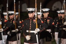 The United States Marine Corps Silent Drill Platoon, Marine Barracks Washington, D.C., performs at the Noncommissioned Officer's parade Aug. 19, 2016. The guest of honor for the parade was Adm. John M. Richardson, chief of Naval Operations, and the hosting official was Gen. Robert B. Neller, commadant of the Marine Corps. (Official Marine Corps photo by Cpl. Andrianna Daly/Released)