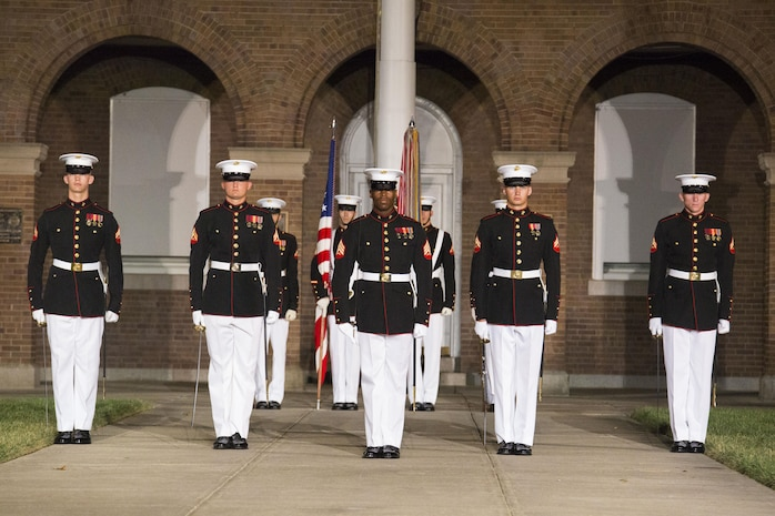 Marines from Marine Barracks Washington, D.C., perform at the Noncommissioned Officer's parade Aug. 19, 2016. The guest of honor for the parade was Adm. John M. Richardson, chief of Naval Operations, and the hosting official was Gen. Robert B. Neller, commadant of the Marine Corps. (Official Marine Corps photo by Cpl. Andrianna Daly/Released)