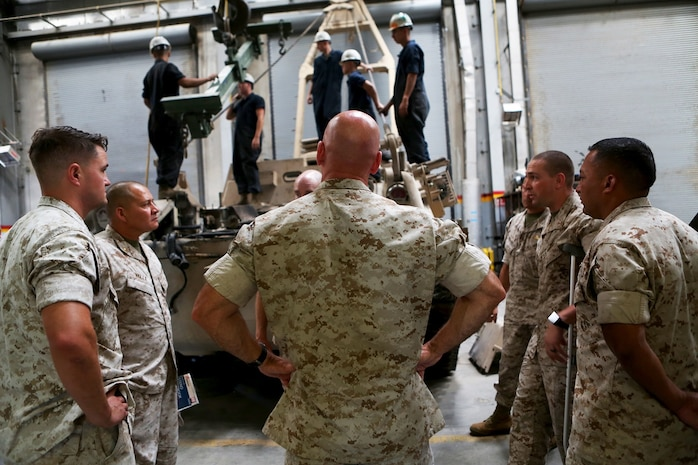 U.S. Marine Brig. Gen. David A. Ottignon observes Marines from Combat Logistics Company 13, Combat Logistics Regiment 15, 1st Marine Logistics Group, as they work to repair a piece of heavy equipment at Marine Corps Air Ground Combat Center Twentynine Palms, Calif. Aug. 12, 2016. Ottignon is the 1st MLG commanding general. The MLG commanding general, sergeant major, and command master chief visited the combat center to speak with unit commanders as well as engage junior Marines and non-commissioned officers to get a sense of how MLG units are doing and what areas could be improved upon. (U.S. Marine Corps photo by Sgt. Carson Gramley/released)