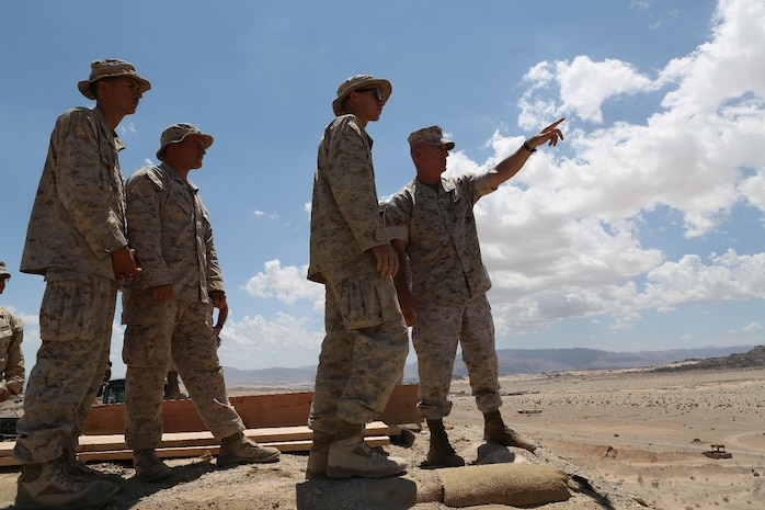 U.S. Marine Brig. Gen. David A. Ottignon provides engineering suggestions to Combat Logistics Battalion 7, Combat Logistics Regiment 1, 1st Marine Logistics Group Marines participating in Integrated Training Exercise 5-16 at Marine Corps Air Ground Combat Center Twentynine Palms, Calif. Aug. 12, 2016. Ottignon is the MLG commanding general. The MLG commanding general, sergeant major, and command master chief visited the combat center to speak with unit commanders as well as engage junior Marines and non-commissioned officers to get a sense of how MLG units are doing and what areas could be improved upon. (U.S. Marine Corps photo by Sgt. Carson Gramley/released)
