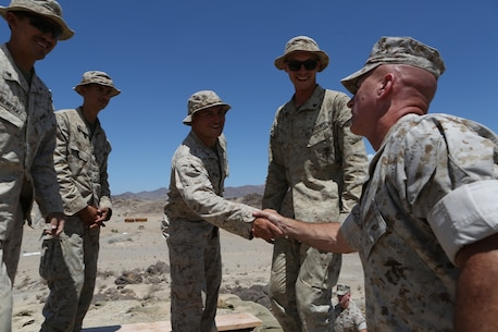 U.S. Marine Brig. Gen. David A. Ottignon speaks to Combat Logistics Battalion 7, Combat Logistics Regiment 1, 1st Marine Logistics Group Marines participating in Integrated Training Exercise 5-16 at Marine Corps Air Ground Combat Center Twentynine Palms, Calif. Aug. 12, 2016. Ottignon is the MLG commanding general. The MLG commanding general, sergeant major, and command master chief visited the combat center to speak with unit commanders as well as engage junior Marines and non-commissioned officers to get a sense of how MLG units are doing and what areas could be improved upon. (U.S. Marine Corps photo by Sgt. Carson Gramley/released)