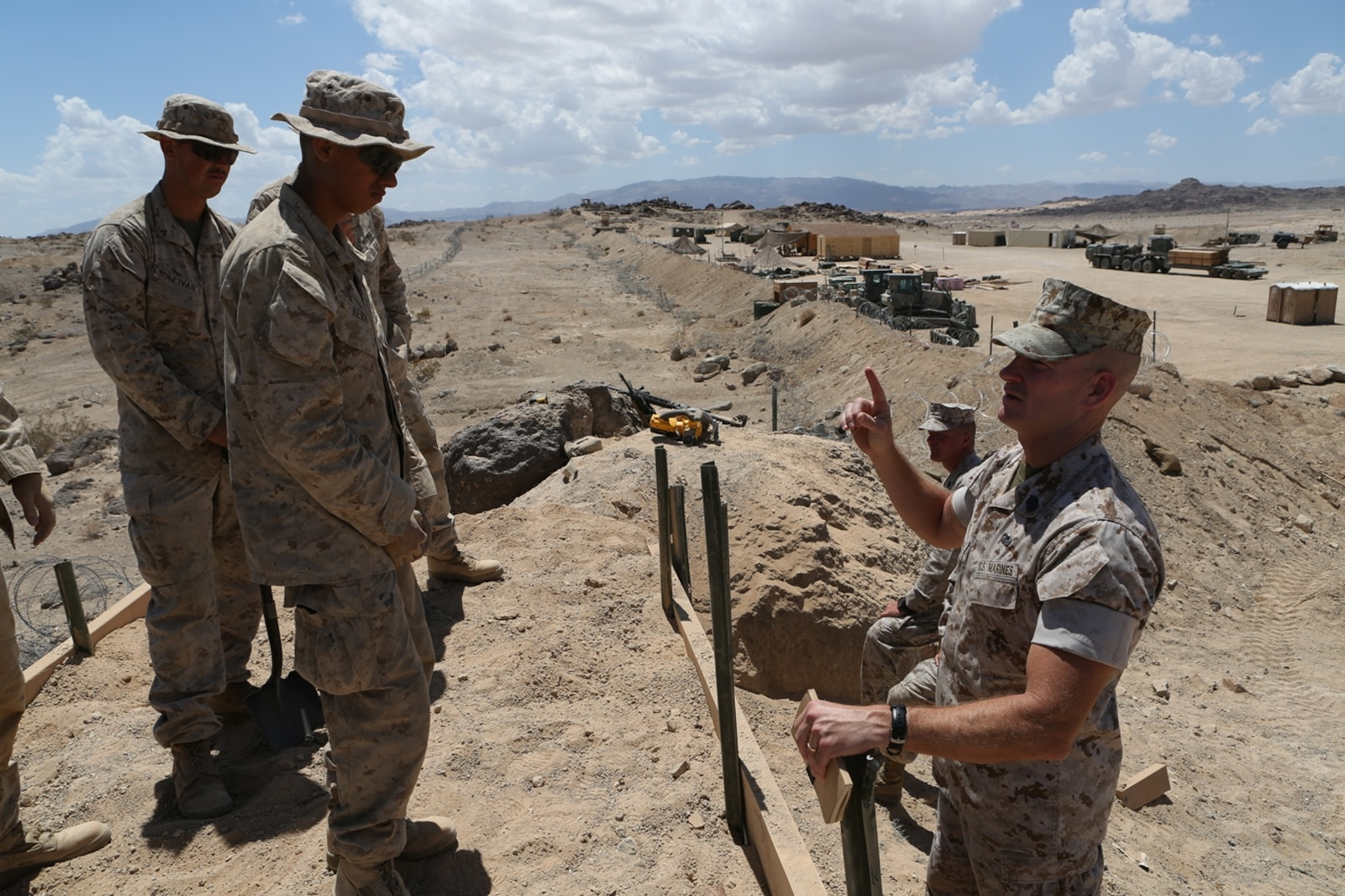 U.S. Marine Sgt. Maj. Troy E. Black speaks to Combat Logistics Battalion 7, Combat Logistics Regiment 1, 1st Marine Logistics Group Marines participating in Integrated Training Exercise 5-16 at Marine Corps Air Ground Combat Center Twentynine Palms, Calif. Aug. 12, 2016. Black is the 1st MLG sergeant major. The MLG commanding general, sergeant major, and command master chief visited the combat center to speak with unit commanders as well as engage junior Marines and non-commissioned officers to get a sense of how MLG units are doing and what areas could be improved upon. (U.S. Marine Corps photo by Sgt. Carson Gramley/released)