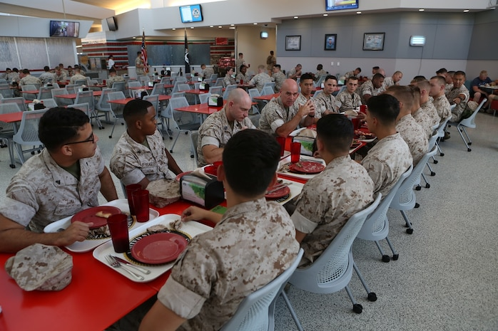 U.S. Marine Brig. Gen. David A. Ottignon holds a discussion over lunch with non-commissioned officers from Combat Logistics Battalion 7, Combat Logistics Regiment 1, 1st Marine Logistics Group, at Marine Corps Air Ground Combat Center Twentynine Palms, Calif. Aug. 12, 2016. Ottignon is the 1st MLG commanding general. The MLG commanding general, sergeant major, and command master chief visited the combat center to speak with unit commanders as well as engage junior Marines and non-commissioned officers to get a sense of how MLG units are doing and what areas could be improved upon. (U.S. Marine Corps photo by Sgt. Carson Gramley/released)