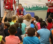 Red Cross volunteer John Miller talks to children at the Quantico Youth Center about hurricanes during a presentation of the Pillowcase Project August 8.