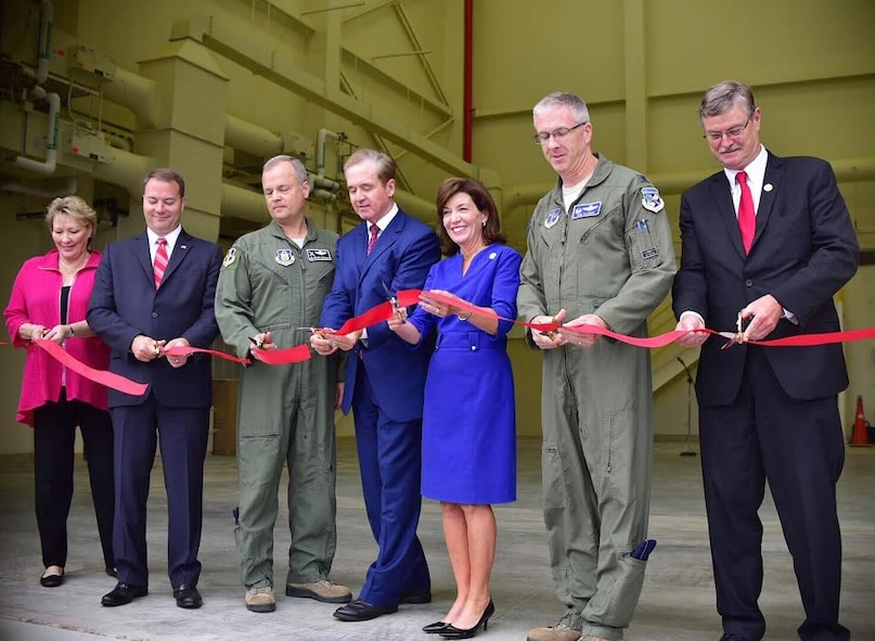 Col. Brian Bowman, 914th Airlift Wing Commander (3rd from left) is joined by Col. Robert Kilgore, 107th Attack Wing Commander and other elected officials to perform a ribbon cutting ceremony at the Niagara Falls Air Reserve Station on Aug. 16, 2016. The ceremony took place to welcome the new flight simulator building on base. (U.S. Air Force photo by Staff Sgt. Richard Mekkri.)
