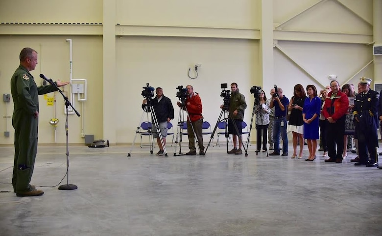 Col. Brian Bowman, commander, 914th Airlift Wing addresses the media and guests at the Niagara Falls Air Reserve Station on Aug. 16, 2016. Bowman and the Wing hosted the event to welcome the new flight simulator building to the base. (U.S. Air Force photo by Staff Sgt. Richard Mekkri)