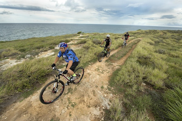 Supporters of the Warriors 4 Life nonprofit veterans group ride alongside the Caribbean in Cabo Rojo, Puerto Rico, Aug. 13, 2016. DoD photo by EJ Hersom