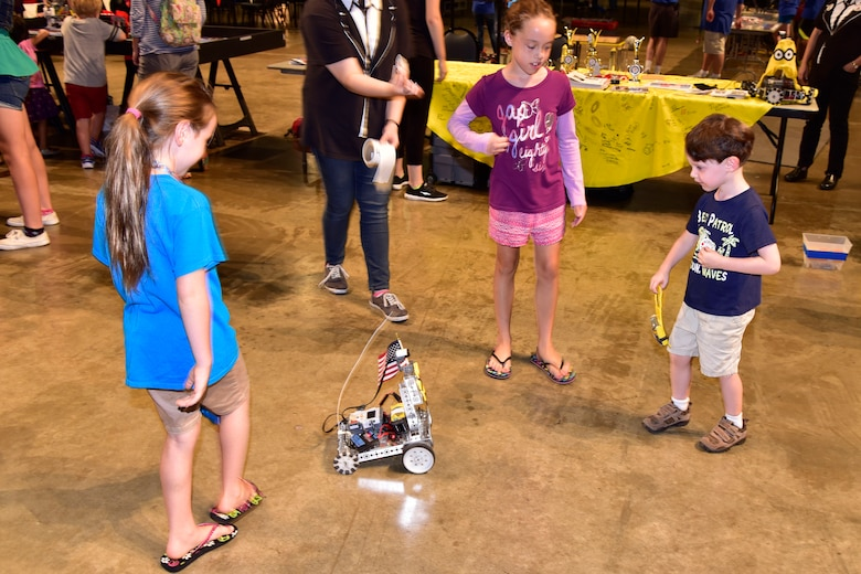 DAYTON, Ohio -- Youth participate in aerospace demonstration stations during Family Day on Aug. 20, 2016, at the National Museum of the U.S. Air Force. (U.S. Air Force photo)