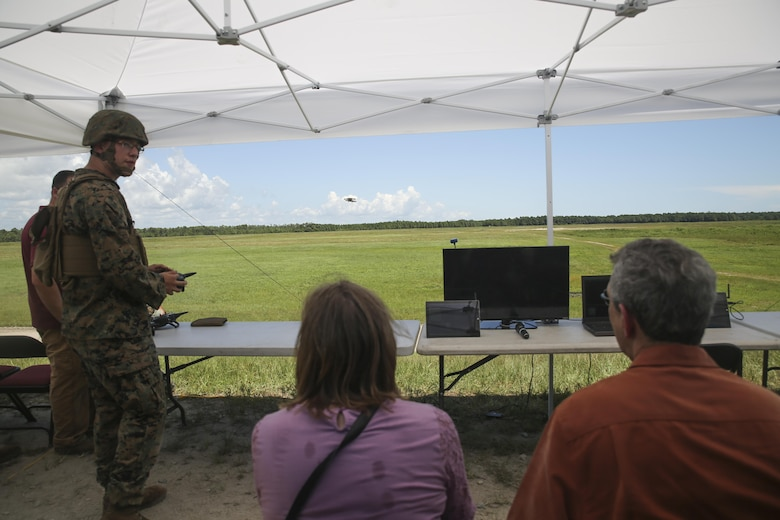 Lance Cpl. Zachary Black, left, a Joint Tactical Aerial Resupply Vehicle operator with Combat Logistics Regiment 25, demonstrates the capabilities of the JTARV to distinguished visitors from the Department of Defense at Camp Lejeune, N.C., Aug. 17. Technological advancements such as the JTARV can potentially allow for safer and quicker resupply missions as opposed to vehicle convoys or piloted aircraft, helping to preserve resources and save lives on the battlefield. (U.S. Marine Corps photo by Sgt. Lucas Hopkins)