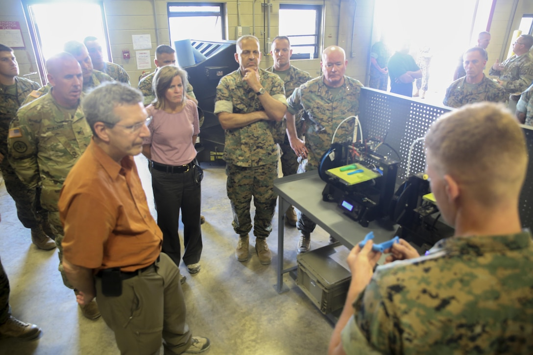 Alan Estevez, left, Principal Deputy under Secretary of Defense for Acquisition, Technology and Logistics, Kristin French, center-left, Principal Deputy under Secretary of Defense for Logistics and Material  readiness, and Lt. Gen. Michael Dana, center, Deputy Commandant of Installations and Logistics, observe a demonstration of 3D printing and additive manufacturing at Camp Lejeune, N.C., Aug. 17. Additive manufacturing can recreate small parts for vehicles and other equipment, which allows for faster reparations. The group visited several units throughout II Marine Expeditionary Force to receive a first-hand look at technological innovation helping to advance logistics operations. (U.S. Marine Corps photo by Sgt. Lucas Hopkins)