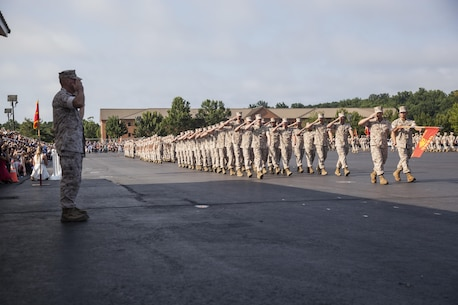 The Commandant of the Marine Corps, Gen. Robert B. Neller, renders a salute to the marching companies during the Alpha, Charlie, and Delta company graduation ceremony aboard Marine Corps Base Quantico, Va., August 6, 2016. Second Lieutenant Trevor Weaser, the tallest Marine in formation, is pictured marching. (U.S. Marine Corps Combat Camera photo by Lance Cpl. Jose Villalobosrocha/Released)