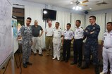 Liaison officers from participating countries of Southeast Asia Cooperation and Training (SEACAT) 2016 review a training brief to prepare for the exercise at Yankee Station, Aug. 19. SEACAT is multilateral exercise held annually with nine participating countries including the United States, Brunei, Indonesia, Malaysia, the Philippines, Cambodia, Bangladesh, Singapore, and Thailand.