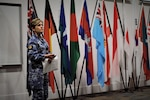 Royal Australian Air Force Warrant Officer Nicole Heffernan, co-host of Exercise Pacific Endeavor 2016, addresses participants during the exercise's opening ceremony in Brisbane, Australia, Aug. 22, 2016. Sponsored by U.S. Pacific Command and hosted by the Australian Defense Force, Pacific Endeavor 2016 is a multinational workshop designed to enhance communication interoperability and expedite humanitarian assistance and disaster relief response in the Indo-Asia-Pacific region. DoD photo by Air Force Master Sgt. Todd Kabalan