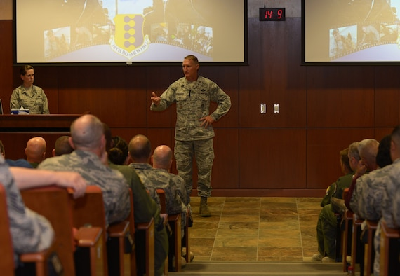 Col. Michael Tichenor, Air Force Global Strike Command inspector general, speaks at the unit mission briefing at Ellsworth Air Force Base, S.D., Aug. 21, 2016. The Unit Effectiveness Inspection consists of three major parts – Airman-to-IG sessions, the main inspection, and feedback, which leads to the unit's final effectiveness rating. (U.S. Air Force photo by Airman 1st Class Donald C. Knechtel/Released)