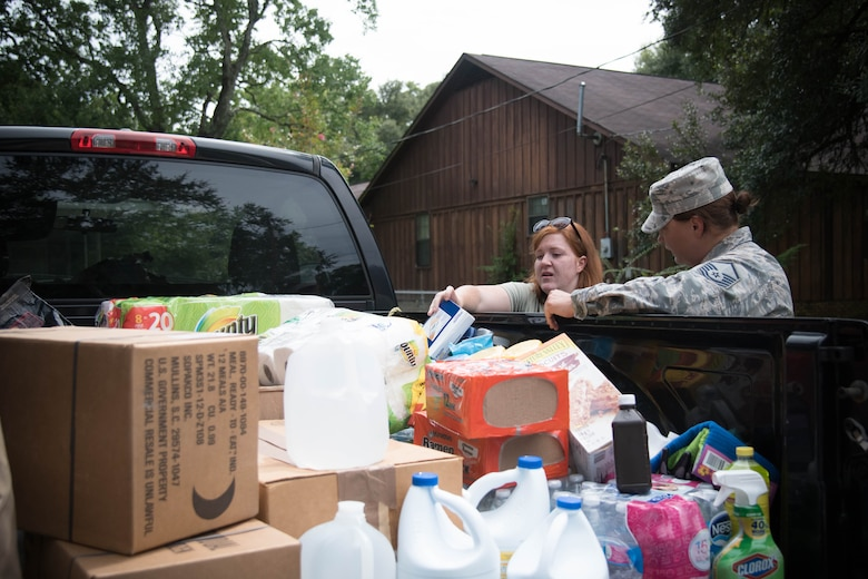 Airmen help one another with response and recovery efforts Aug. 19 after flooding in Baton Rouge, Louisiana. (U.S. Air Force photo by Senior Airman Heather Heiney)