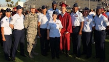 Team March members pose for a photo with Sean Kelly following his high school graduation ceremony in Long Beach, June 16, 2016. Sean is the son of Chief Master Sergeant Ericka Kelly, Command Chief Master Sergeant, Air Force Reserve Command, Robins Air Force Base, Georgia.