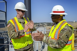 U.S. Army Corps of EngineersCommand Sgt. Maj. Antonio S. Jones talks with 1LT William Mengon about the Folsom Dam auxiliary spillway during a visit on Aug. 17, 2016. Jones visited Sacramento District projects at Folsom as well as Englebright and Black Butte Lakes during his two-day visit.