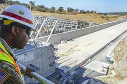 U.S. Army Corps of Engineers Command Sgt. Maj. Antonio S. Jones,  looks down over the Folsom Dam auxiliary spillway chute from the control structure during a visit on Aug. 17, 2016. CSM Jones visited Sacramento District projects in Folsom as well as Black Butte and Englebright Lakes.