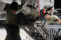 Staff Sgt. Nicholas Mischiara, 25th Aircraft Maintenance Unit weapons load crew chief and Senior Airman Alexis Benitez, 25th AMU weapons load crewmember, load munitions onto an A-10 Thunderbolt II on Osan Air Base, Republic of Korea. The loading of munitions was part of exercise Beverly Herd 16-2, designed to test the readiness of the 51st Fighter Wing. (U.S. Air Force photo by Staff Sgt. Jonathan Steffen)