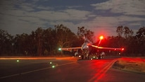 An F/A-18C Hornet assigned to Marine Fighter Attack Squadron 122 taxis to the runway for a night flight during Exercise Pitch Black 2016 at Royal Australian Air Force Base Tindal, Australia, Aug. 17, 2016. The flying squadron executed large force close air support, air interdiction, armed reconnaissance, and strike coordination and reconnaissance missions over the three week training evolution. The biennial, multinational exercise involves approximately 10 allied nations and prepares these forces for possible real-world scenarios. The bilateral effort amongst Exercise Pitch Black 2016 furthermore showcases the strength amongst various militaries and solidifies the relationship across the Pacific region.