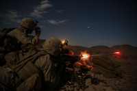 Lance Cpl. Login Loftis, a machine gunner with Company F, 2nd Battalion 5th Marine Regiment fires a M240 medium machine gun as Lance Cpl. Krikland Harrington, a machine gunner with Company F, 2/5, looks through his night vision optic to guide Loftis onto his target during Integrated Training Exercise 5-16 at Marine Air-Ground Combat Center Twentynine Palms Calif., August 18, 2016.  ITX is designed to bring together the ground combat, air combat and logistics combat elements of the Marine Corps into one fully capable and lethal unit ready to respond to global uncertainty.