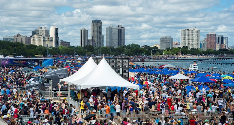 A crowd fills the shoreline of Lake Michigan during the 58th Annual Chicago Air and Water Show in Chicago, Aug. 21, 2016. The show's headliners were the USAF Thunderbirds, U.S. Army Golden Knights and the U.S. Navy Leap Frogs. (U.S. Air Force photo by Senior Airman Ryan J. Sonnier)