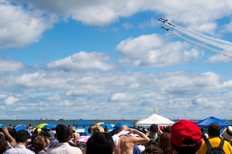 A crowd watches as the AeroShell Acrobatic Team performs aerial stunts during the 58th Annual Chicago Air and Water Show on the shoreline of Lake Michigan in Chicago, Ill., Aug. 21, 2016. The show's headliners were the USAF Thunderbirds, U.S. Army Golden Knights and the U.S. Navy Leap Frogs. (U.S. Air Force photo by Senior Airman Ryan J. Sonnier)