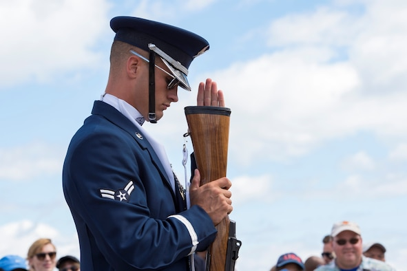 Airman 1st Class Tyler Reynolds, U.S. Air Force Honor Guard Drill Team member inspects the butt of his rifle during a four-man drill at the 58th Annual Chicago Air and Water Show on the shoreline of Lake Michigan in Chicago, Aug. 21, 2016. The show's headliners were the USAF Thunderbirds, U.S. Army Golden Knights and the U.S. Navy Leap Frogs. (U.S. Air Force photo by Senior Airman Ryan J. Sonnier)