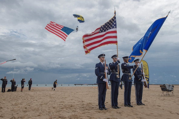 Members of the U.S. Air Force Honor Guard Drill Team present colors during the 58th Annual Chicago Air and Water Show on the shoreline of Lake Michigan in Chicago, Ill., Aug. 20, 2016. The show's headliners were the USAF Thunderbirds, U.S. Army Golden Knights and the U.S. Navy Leap Frogs. (U.S. Air Force photo by Senior Airman Ryan J. Sonnier)