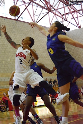 USA's Vanessa Lamison scrambles for the ball with Brazil's Soeli Garvao Zakrzeski during the CISM Military World Basketball Championship, July 29, 2016 at Camp Pendleton, Calif.