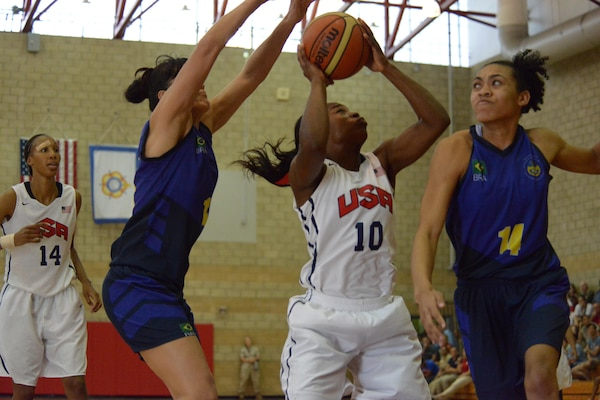 Spc. Donita Adams of the Maryland Army National Guard takes a shot despitedbeing double-teamed by Brazilian defenders during the final game of the CISM Women's Basketball Championship at Camp Pendleton, Calif., July 29, 2016.