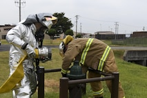 Firefighters from the 51st Civil Engineer Squadron hook up a water hose to a fire hydrant during a mock improvised explosive device exercise on Osan Air Base, Republic of Korea, Aug. 23, 2016. The mock IED is a scenario during exercise Beverley Herd 16-2 to test first responders on their emergency capabilities. (U.S. Air Force photo by Staff Sgt. Jonathan Steffen)